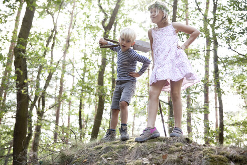 Boy and girl standing in forest on a hill with spade - MFRF01029