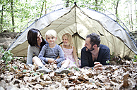 Happy family with tent in forest - MFRF01032