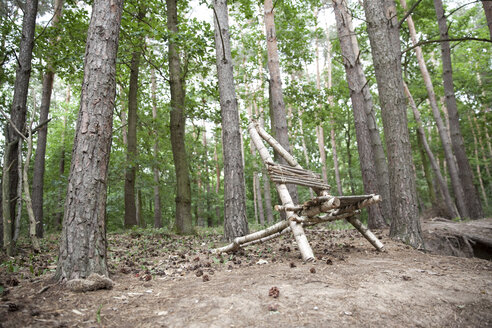 Self-made wooden chair in forest - MFRF01053