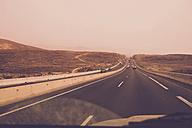 Spain, Tenerife, road at sunset seen from inside driving car - SIPF01690
