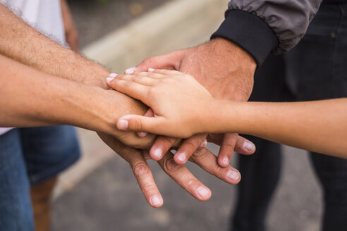 Family stacking hands, close-up - SIPF01696