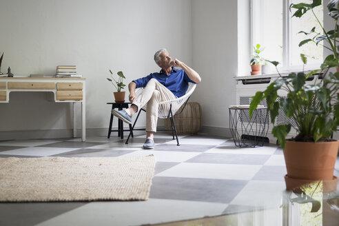 Mature man sitting at home thinking - RBF05854