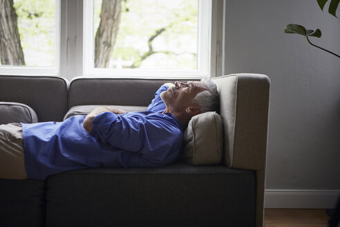 Mature man lying on couch at home - RBF05908