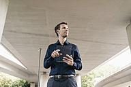 Businessman using portable glass device - KNSF02493
