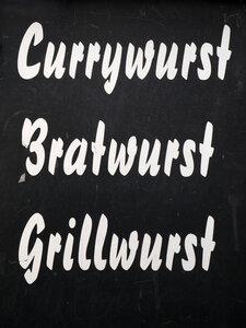 Sign offering three german sausage delicacies - JMF00402