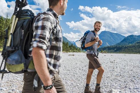 Germany, Bavaria, two hikers walking in dry creek bed - DIGF02788