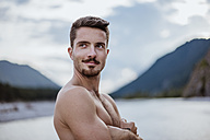 Germany, Bavaria, portrait of shirtless young man in nature - DIGF02845