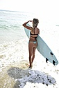 Woman at the ocean with surfboard - ECPF00052