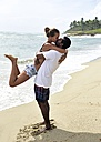 Happy couple kissing on the beach - ECPF00082