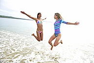 Two women having fun on the beach - ECPF00103