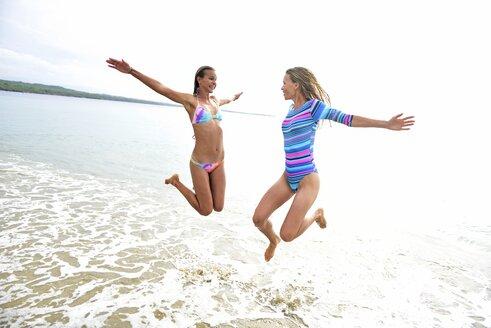 Two women having fun on the beach - ECPF00103
