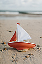 Toy boat an the beach - KNSF02538