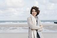 Woman standing on the beach - KNSF02553