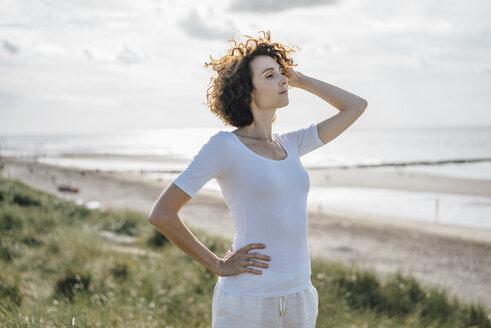 Woman standing in beach dune - KNSF02613