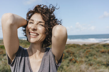 Portrait of happy woman at the coast - KNSF02664