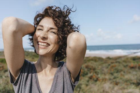 Portrait of happy woman at the coast - KNSF02664