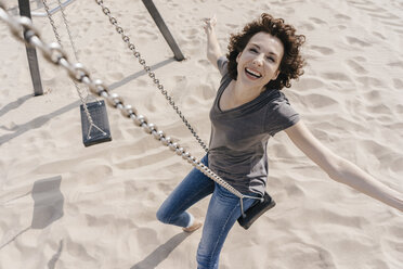 Happy woman on a swing - KNSF02676