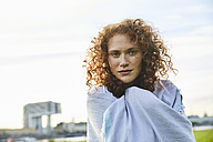 Germany, Cologne, portrait of freckled young woman - FMKF04470