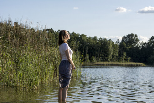 Young woman enjoying the sun at a lake - LMF00762