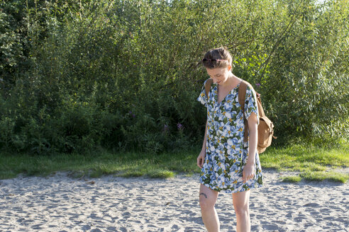 Young woman with rucksack walking in nature - LMF00771