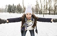 Woman having fun ice skating - HAPF02122