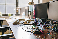 Desk with confetti and streamers on computer after a birthday party - KNSF02725