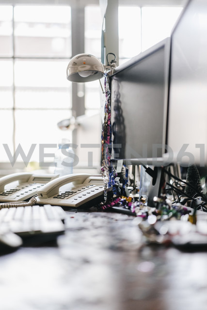 Desk with confetti and streamers on computer after a birthday party - KNSF02743