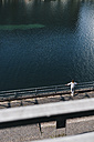 Woman stand in by the river, watching the water - KNSF02857