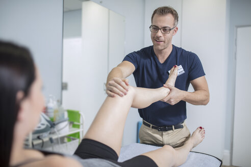 Woman receiving treatment from physio - ZEF14575