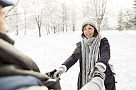 Happy senior couple in winter landscape - HAPF02137