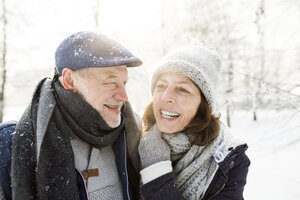 Portrait of happy senior couple in winter landscape - HAPF02140