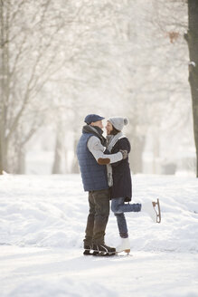 Senior couple hugging on frozen lake - HAPF02152