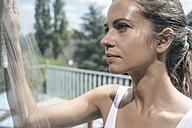 Woman cleaning balcony window - JOSF01549