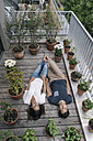 Relaxed couple lying on balcony - JOSF01588