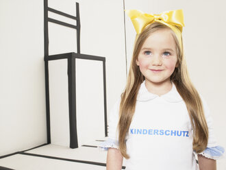Portrait of smiling little girl dressed up as Alice in Wonderland - FSF00958