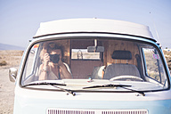 Spain, Tenerife, woman sitting in van taking picture with camera - SIPF01729