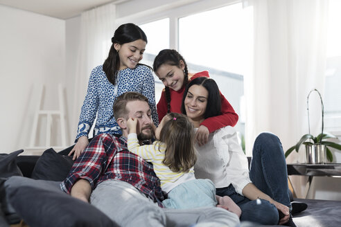 Parents and three daughers on sofa in living room - SBOF00665