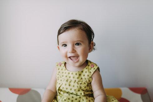 Portrait of happy baby girl wearing a dress - GEMF01795