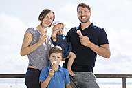 Happy family with two children eating ice cream - MIDF00856