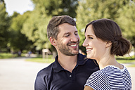 Portrait of happy couple outdoors - MIDF00865