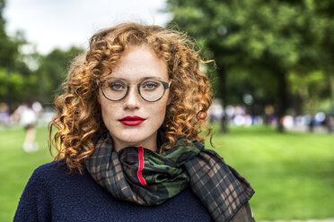 Portrait of redheaded young woman wearing glasses - FMKF04491