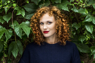 Portrait of redheaded young woman with red lips - FMKF04494