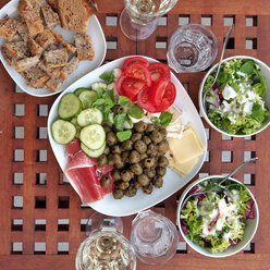 dinner with olives, cucumber, tomatoes, cheese, salad, bread, water and wine, Berlin, Germany - NGF00398