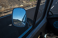Spain, Tenerife, El Teide, Empty road in wing mirror - SIPF01746