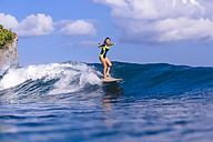 Indonesia, Bali, woman surfing - KNTF00886