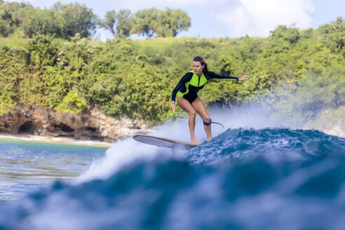 Indonesia, Bali, woman surfing - KNTF00892