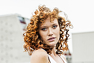 Portrait of redheaded woman outdoors - FMKF04523