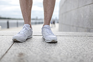 Close-up of man wearing running shoes - VPIF00072