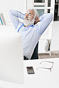 Mature man with beard relaxing at desk - JOSF01709