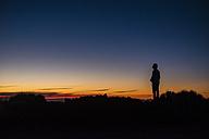 Spain, Tenerife, man on El Teide vulcano at twilight - SIPF01753